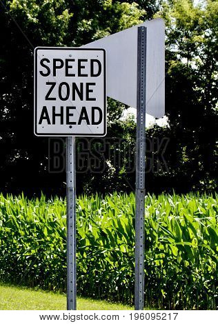 The vertical format shows a speed zone sign.