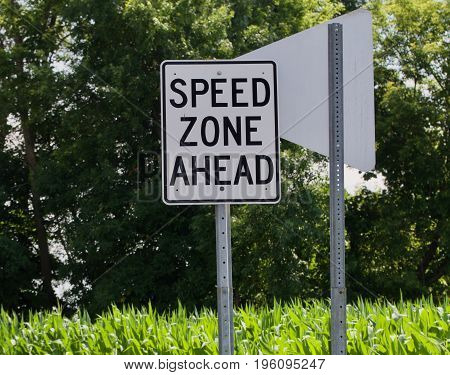 The horizontal format shows a speed zone sign.