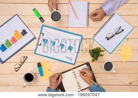 Couple having a meeting in a business office. Businessmen working on desk.