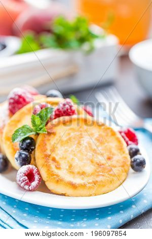 Cottage cheese pancakes syrniki curd fritters with berries