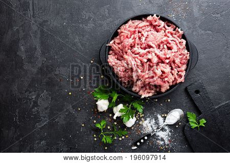 Mincemeat, minced or ground meat on black background