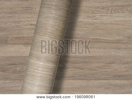 rolled wood-textured surface over same full frame textured background