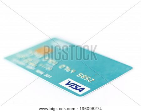 BANGKOK THAILAND - 21 JULY 2017: Closeup studio shot of credit cards issued by the three major brands American Express VISA and MasterCard.