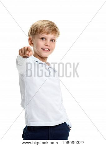 Portrait of cheerful smiling young schoolboy pointing on camera