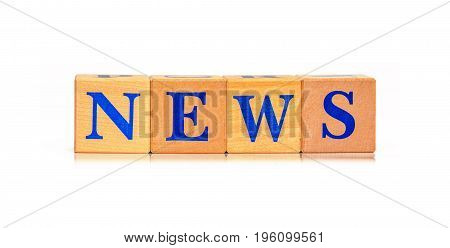 Wooden blocks with word News isolated on white background