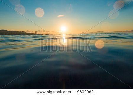 Sunset with underwater part  by waterline