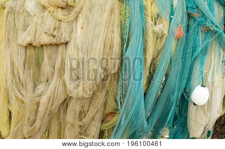 Many fishing nets laid outdoor
