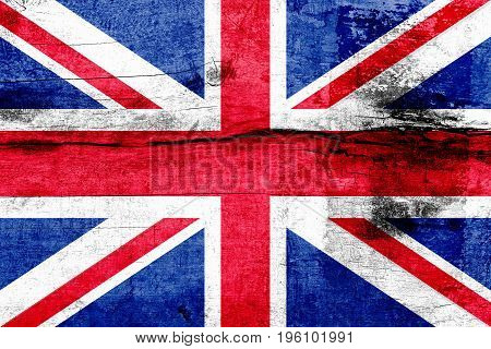 Great Britain Flag Painted On A Weathered Wooden Board. Flag Of United Kingdom. Textured Abstract Ba