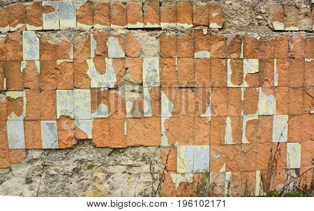 Old wall tiles. Grunge background. Aged tiling surface for design. Texture of old red brick wall.