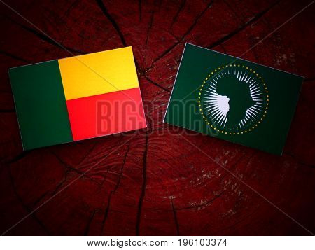 Benin Flag With African Union Flag On A Tree Stump Isolated