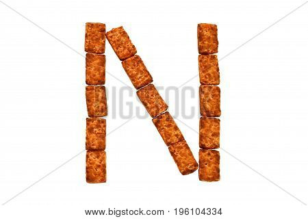 Alphabet made up of cookies on a white isolated background. letter N