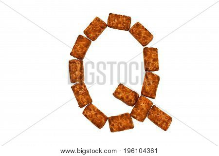 Alphabet made up of cookies on a white isolated background. letter Q