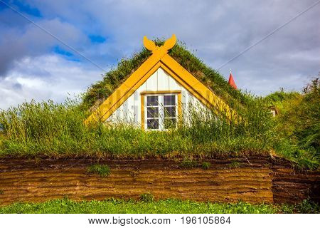 Interesting ethnographic museum Glaumbaer in Iceland. Facade of the farmhouse and outbuildings, covered with grass. The concept of the historical and cultural tourism