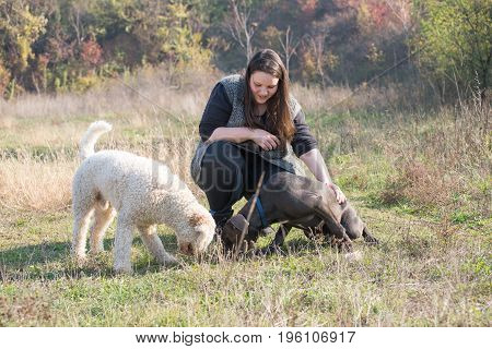 Girl and her dogs during a obedience training