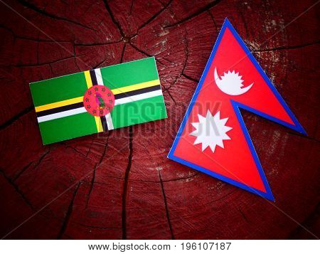Dominica Flag With Nepali Flag On A Tree Stump Isolated