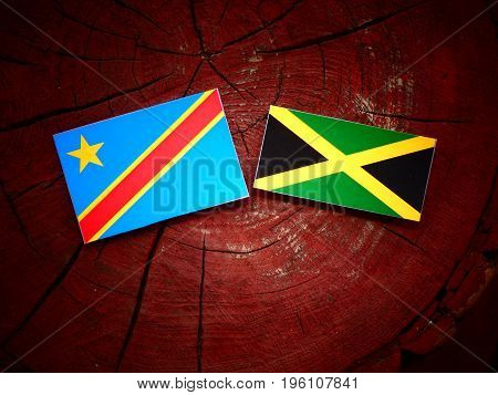 Democratic Republic Of The Congo Flag With Jamaican Flag On A Tree Stump Isolated