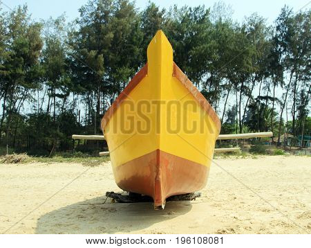 Old yellow  Fishing boat on the beach