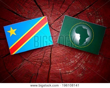 Democratic Republic Of The Congo Flag With African Union Flag On A Tree Stump Isolated