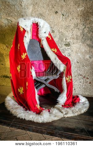 Red polish royal mantle on the chair
