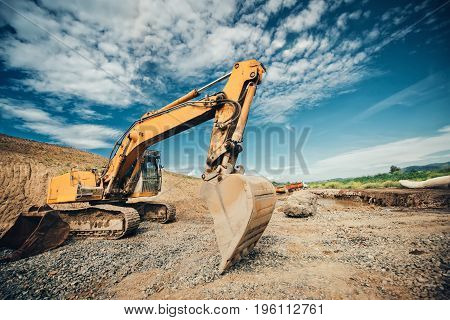 Industrial Truck Loader, Excavator With Heavy Duty Scoop Moving Earth And Loading Dumper Trucks Duri