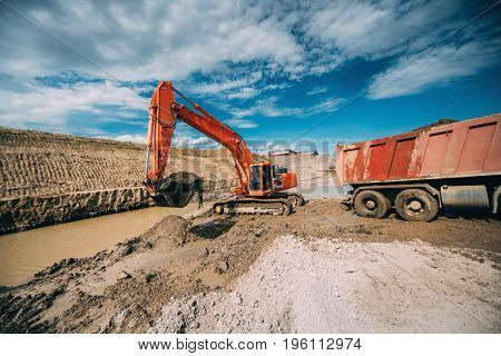 Construction Industry - Excavator Working On Highway Construction Site. Details Of Digging In Water