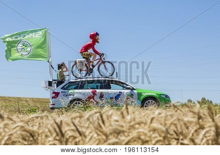 Saint-Quentin-Fallavier France - July 16 2016: The globetrotter mascot of Skoda during the passing of Publicity Caravan in a wheat plain in the stage 14 of Tour de France 2016.