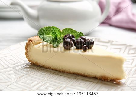 Plate with delicious cheesecake and berries, closeup