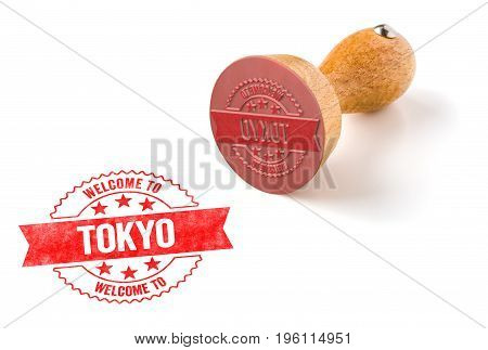 A Rubber Stamp On A White Background - Welcome To Tokyo