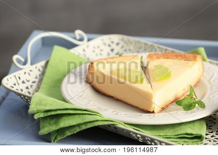 Plate with delicious slices of cheesecake on green napkin