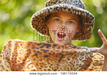 Girl as leopard with creative face painting  in school play