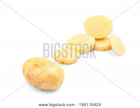 A group of perfectly round slices of chopped potatoes and a whole veggie isolated over the bright white background. Potatoes full of starch. Agriculture, plant, farming concept.
