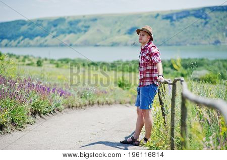 Handsome Young Man In Casual Clothing Taking A Walk In The Countryside.