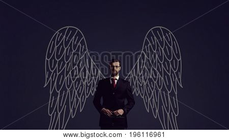 Business angel over dark background. Investment, business, sponsor concept.