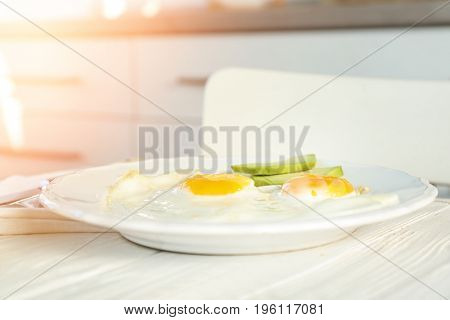 Delicious breakfast with over easy eggs on kitchen table