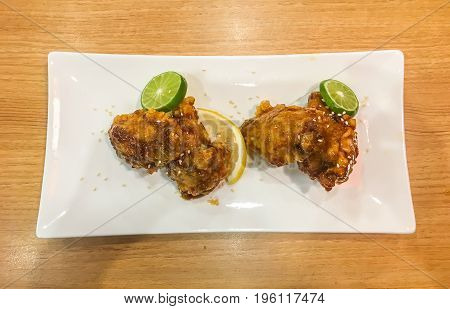 Japanese Grilled fish and foie gras with teriyaki sauce unagi with pickled ginger white background