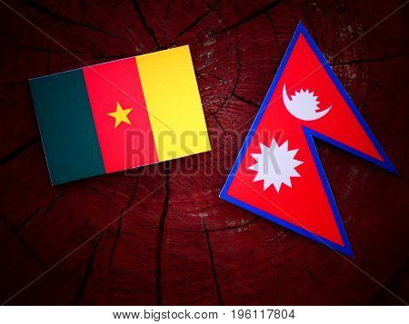 Cameroon Flag With Nepali Flag On A Tree Stump Isolated