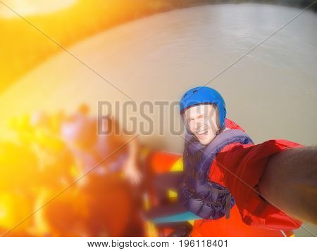 male athlete in the water on a boat is photographed for action in the summer. Concept group of people riding on rafting