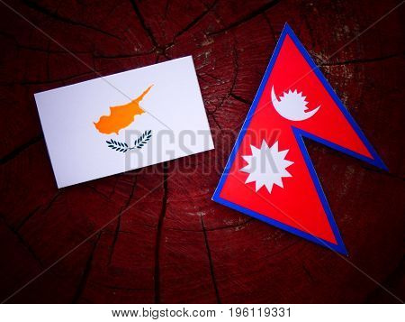 Cypriot Flag With Nepali Flag On A Tree Stump Isolated