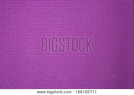 Purple yoga mat as background