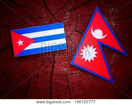 Cuban Flag With Nepali Flag On A Tree Stump Isolated