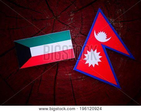 Kuwaiti Flag With Nepali Flag On A Tree Stump Isolated