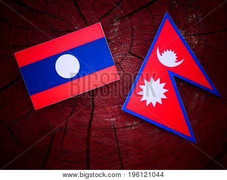 Laos Flag With Nepali Flag On A Tree Stump Isolated