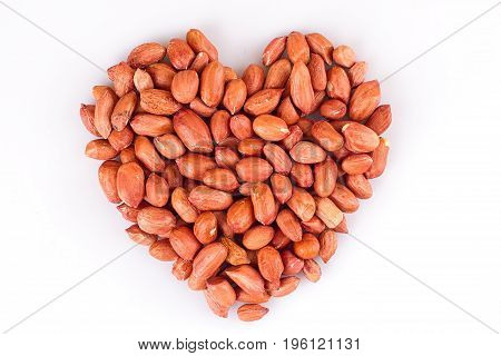 Peanuts in heart symbol isolated on white