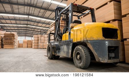 Yellow forklift in a large warehouse. Industry concept.