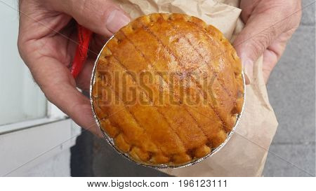 Man holding Traditional Meat Pie