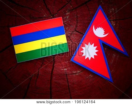 Mauritius Flag With Nepali Flag On A Tree Stump Isolated
