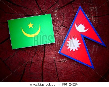 Mauritania Flag With Nepali Flag On A Tree Stump Isolated