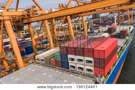 container ship in import export and business logistic.By crane Trade Port Shipping.cargo to harbor.Aerial view.Top view.