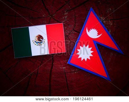 Mexican Flag With Nepali Flag On A Tree Stump Isolated