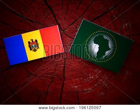 Moldovan Flag With African Union Flag On A Tree Stump Isolated